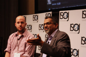 Robert Quigley, professor from UT-Austin, and Raju Narisetti, managing editor from the Wall Street Journal Digital Network, speaks during the 13th International Symposium on Online Journalism on Apr. 21, 2012. (Knight Center)